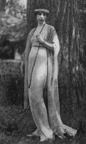 Clarisse Coudert, who married Condé Nast, wearing a Fortuny tea gown. This one has no tunic but is finely pleated, in the Fortuny manner, and falls in long lines, closely following the figure, to the floor.