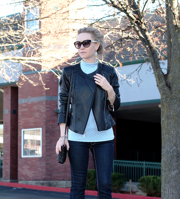 Ann Robie Fashion style: blue quilted top, jeans, black leather jacket, sky blue earrings