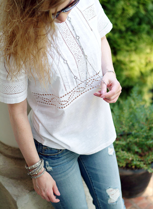 Details of the casual outfit with a linen embroidered T-Shirt Ann Taylor and boyfriend jeans by petite style blogger AnnRobieFashion - bracelets & necklace