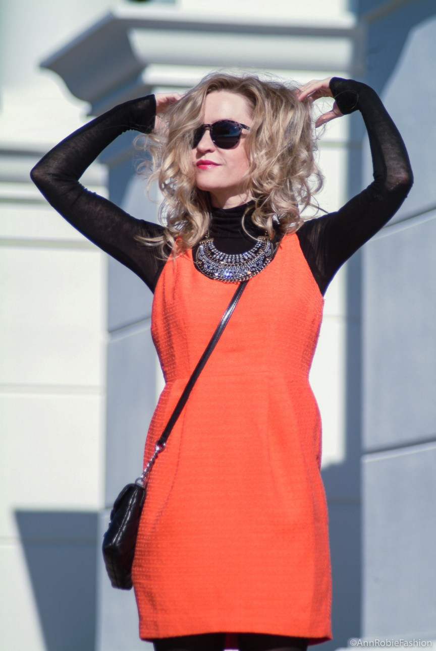Urban contrasts: orange sleeveless dress, black turtleneck sweater, suede heels - petite street style by fashion blogger AnnRobieFashion