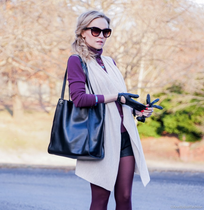 How to wear shorts in winter: black leather shorts Forever 21, beige vest Ann Taylor, plum turtleneck sweater Ann Taylor, black ankle booties Vince Camuto - outfit idea by style blogger AnnRobieFashion