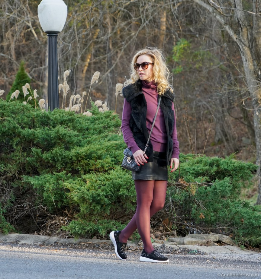 Petite street style in winter: sleeveless faux fur vest Rachel Zoe, plum turtleneck Ann Taylor, black leather skirt Forever 21, Zara leather sneakers with floral details by petite style blogger AnnRobieFashion