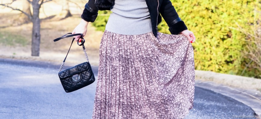 What to wear with pleated pale pink midi skirt: Pale pink midi skirt Banana Republic, grey turtleneck sweater LOFT, patent leather boots, faux fur jacket White House Black Market - outfit by petite style blogger AnnRobieFashion