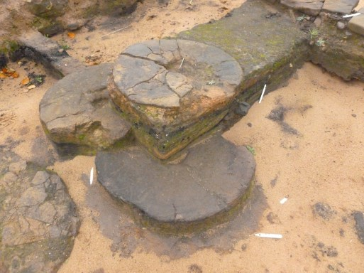 Three rotary querns reused in successive hearths
