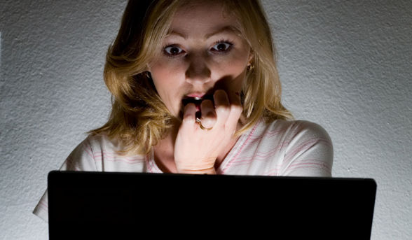woman scared at computer