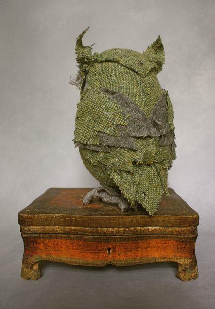 green perching owl