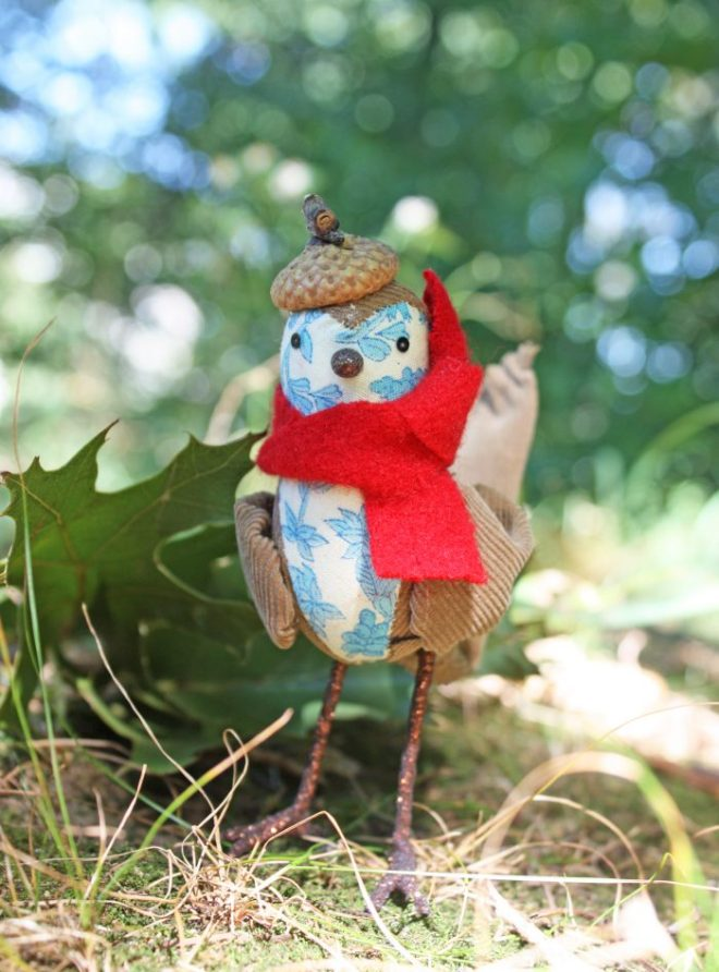 handmade bird with an acorn beret