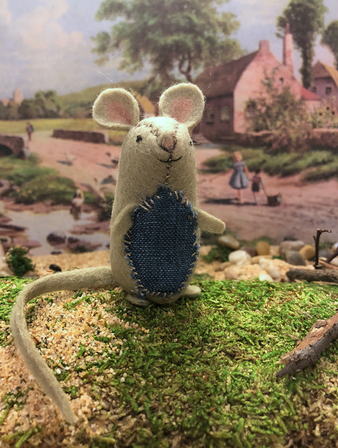 felt mouse in a countryside diorama