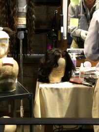 Some wigs. Snape's had a blue tint to it so the cameras would pick it up as dark black.