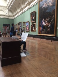 This guy was just sitting here, sketching this painting.