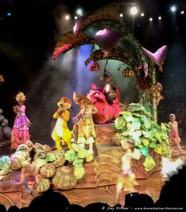 Timon, Pumbaa and live actors play the other characters in the Festival of the Lion King.