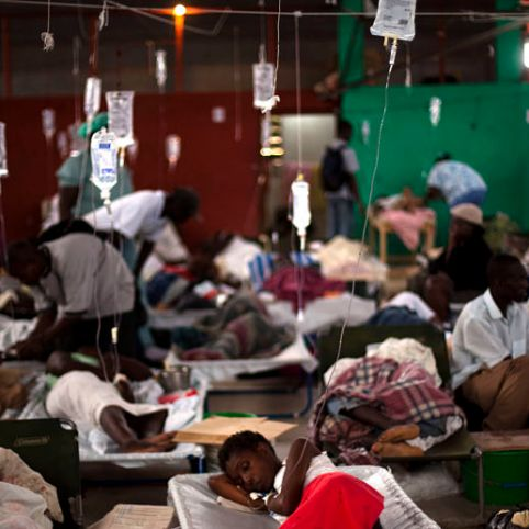 FILE - In this Tuesday Nov. 23, 2010 file photo, people suffering cholera symptoms are treated in a sports center converted into a cholera treatment center in Cap Haitien, Haiti. South Korea's Yonhap News Agency announced Tuesday, July 19, 2011 that Associated Press photographer Emilio Morenatti won the top prize of its press photo contest, that aims to promote the United Nations' Millennium Development Goals. Morenatti won with his entry
