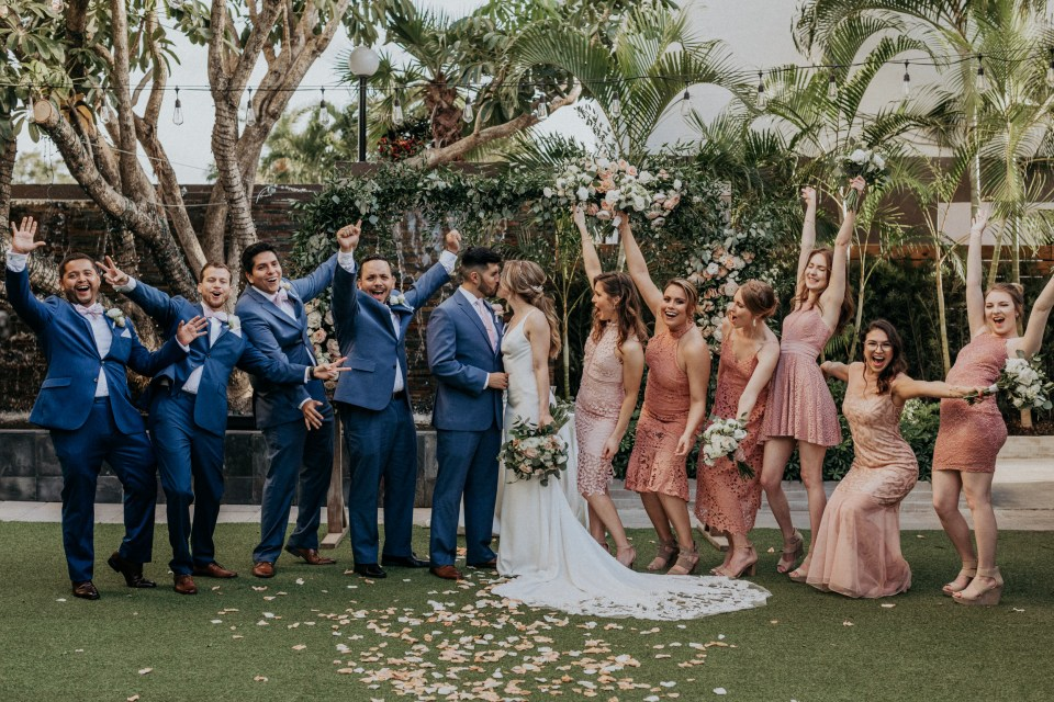 Funny posed wedding party photo.