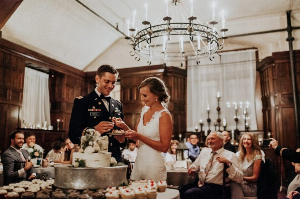 Bride and groom cutting their cake during their reception at Homewood Asheville.