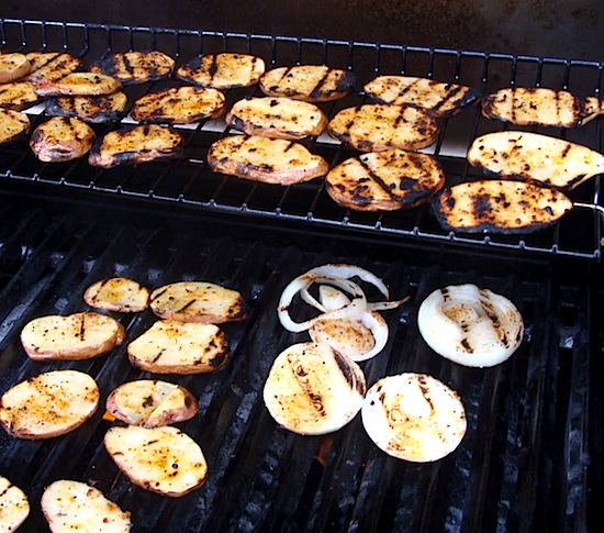Grilled potato planks on grill