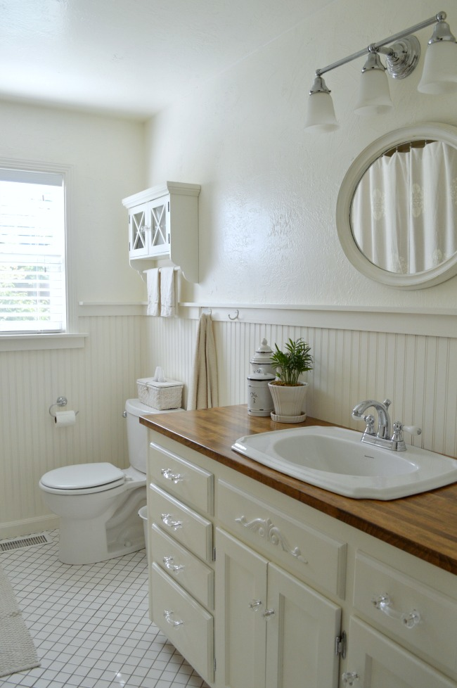 2016 Main bath white vanity with wood counter
