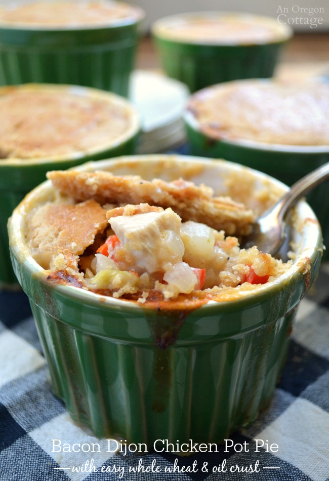 This easy, from scratch chicken pot pie is flavored with bacon and Dijon and changes up the vegetables with cabbage and peppers - we licked our bowls clean!