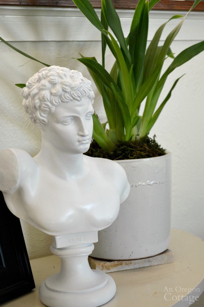 $5.99 thrifted classical bust transformed with white paint. There are so many ways to use this type of statue in your decor!