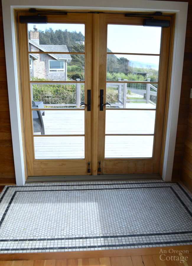 French doors with tile rug at Reed House Manzanita vacation rental