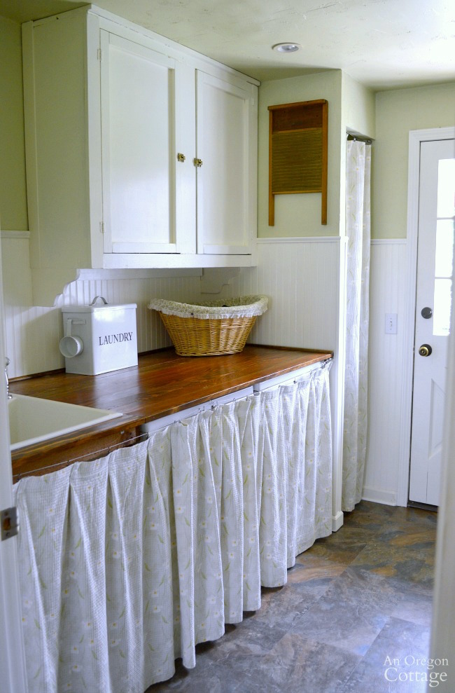 Laundry-Mudroom Makeover after-laundry area with wood counter and vintage cabinet.