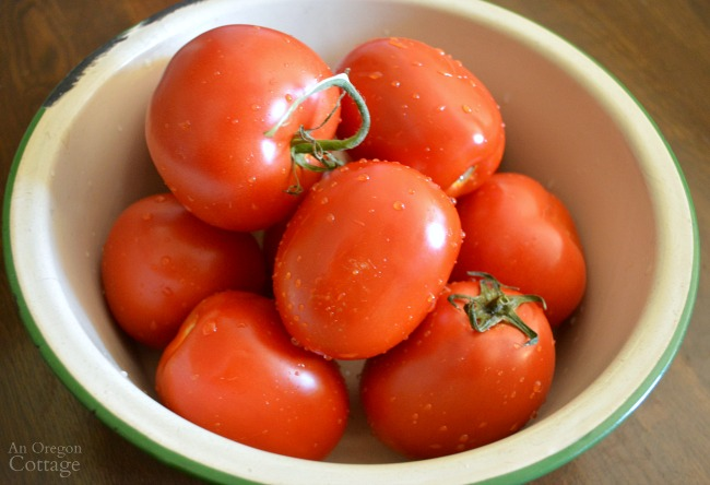 Washed tomatoes in enamel bowl