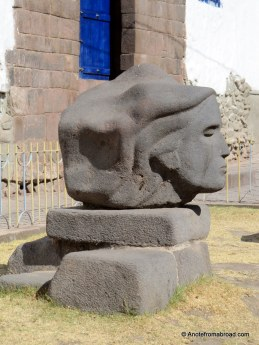 Carved stone in front of Andahuaylillas