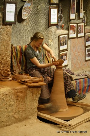 Tali demonstrates her pottery skills for the group