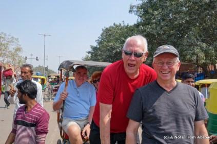 Dick and Tim hijack a bike rickshaw as Gary and Jan enjoy the ride