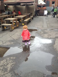 little girl dancing in the rain