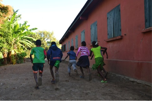 Pupils playing in the cleaned area behind the school building that had previously been used for open defecation. Tsimahavaobe primary school, Morondava commune, Menabe region, Madagascar. July 2013