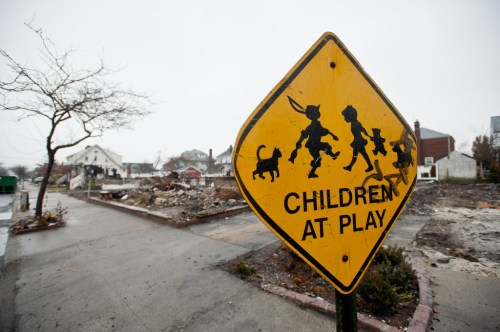 A street sign among the burnt out homes in the after math of Superstorm Sandy (photo credit: Save the Children)