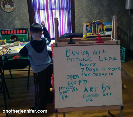 "We've turned part of our second floor into an art studio and ""store."" G made the sign with Biz's direction."