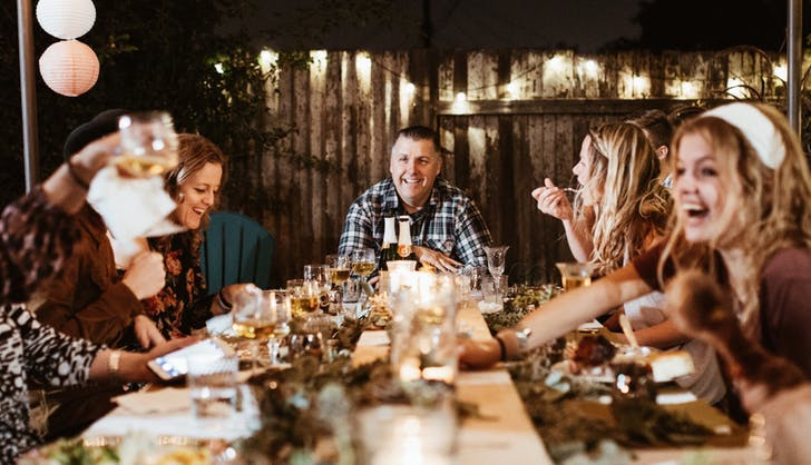 a_large_group_eating_dinner_together.jpg