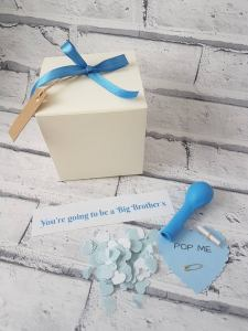 Balloon in a box pregnancy announcement