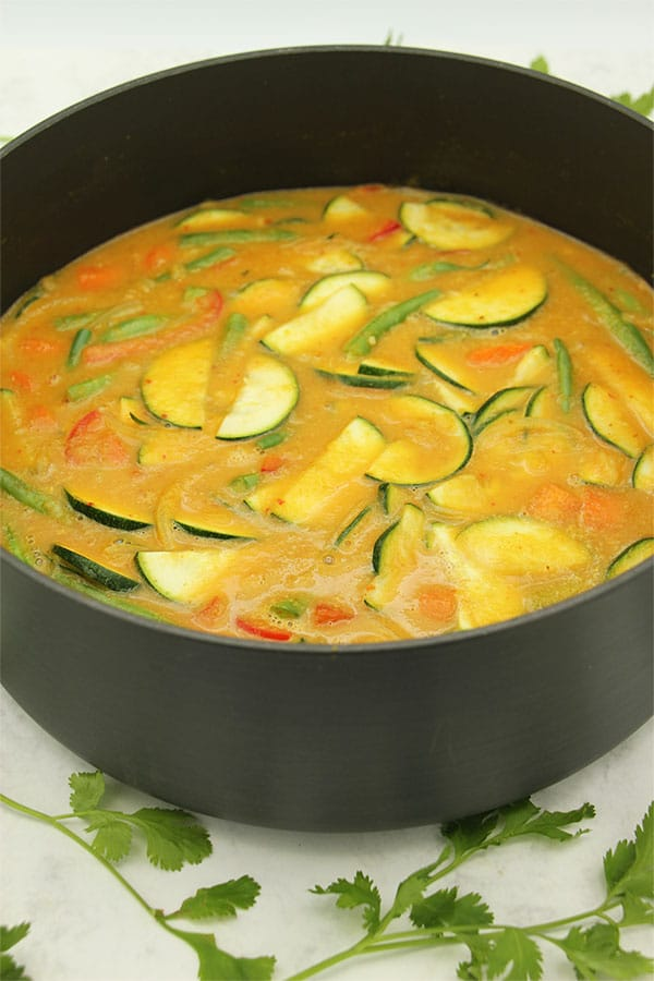 Quick mango curry in black pan