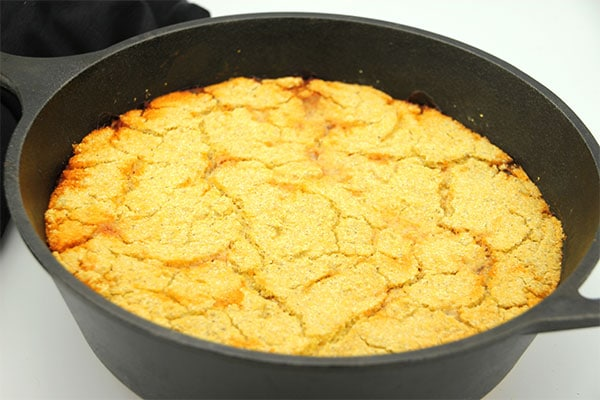 vegan tamale pie with cornmeal crust baked in black cast iron pan.