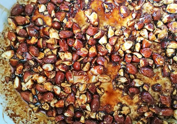 5-spice almonds in baking dish.