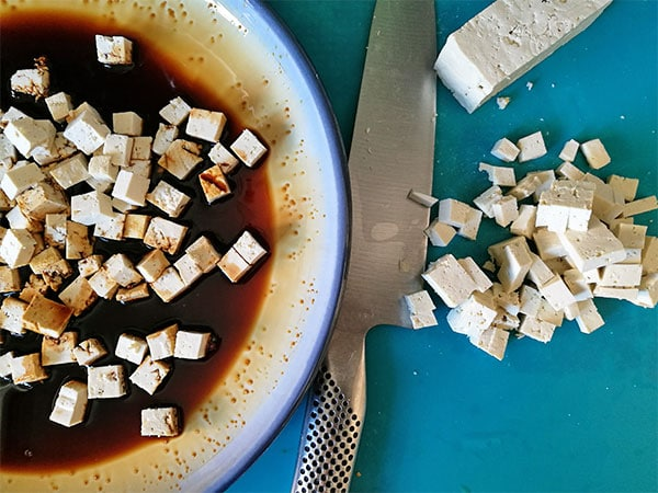 Tofu is cubed and marinated for smoky tofu bacon.