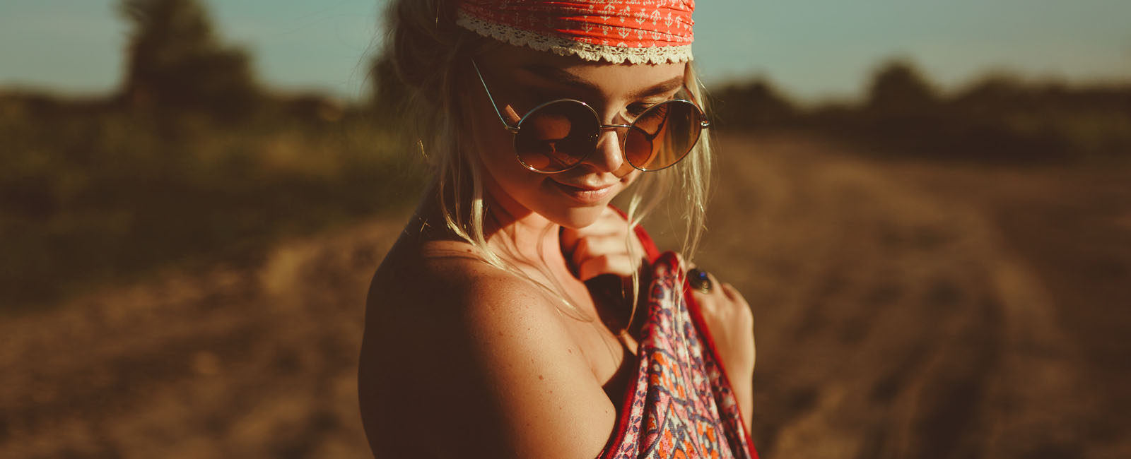girl wrapped in scarf wearing sunglasses in desert