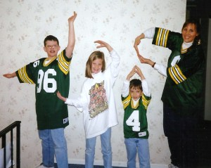 That's the No. 4 jersey just a year after we bought it. It has taken me 16 years to figure out what Charlie, Katherine, Vinnie and Elaine are spelling out in this picture but last night it dawned on Molly and me. It's KCAP! (or PACK, spelled backwards.) Obviously.