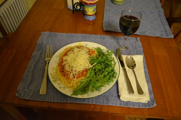 I realized you can't see my beautiful sauce under all of that grated cheese -- this is Wisconsin after all -- but we really thought it was delicious. Next time you have a couple of hours and some nearly rotten tomatoes, we think you should try it too!