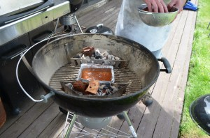 Add the hickory chips to the coals.