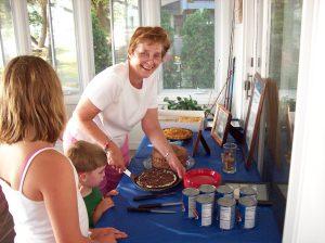 Aunt Doris serving up pie at a family reunion