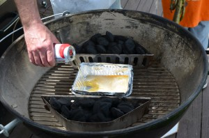 Here's how you set up the indirect heat: Pour beer and coke into the drip pan, place a lighter cub on each side and cover with charcoal.