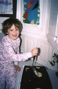 This is my niece Hannah, circa 2003, flipping pancakes for us on our big ole griddle.
