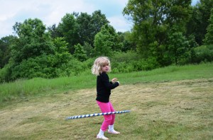 My little peanut niece Erin gave it a whirl, though it was way too big for her. We are now three generations of hula hoopers.