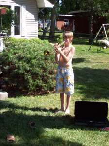 This is Michael as an 11-year old somewhat scrawny trumpet master.