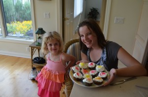 Sprinkling the cupcakes was Erin's favorite part.