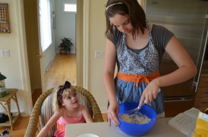 While Erin was not pleased that Molly made her pull her hair back to cook, she did enjoy this little lesson in cupcake baking.