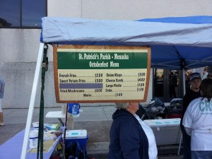 Each booth at the Appleton Oktoberfest raises money for charity. Check out the menu at St. Patrick's booth.